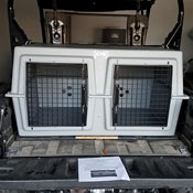 A Honda Pioneer fits our kennels perfectly.
