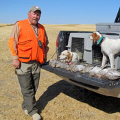 A Hunter with his Dogs and their Easy Loader Kennel